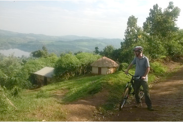 mountain biking near Kibale forest along single tracks through small villages and farms