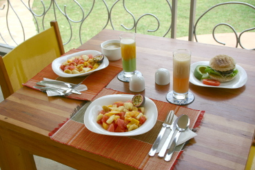 table set for lunch with fresh juices and fruit salads at Dutchess